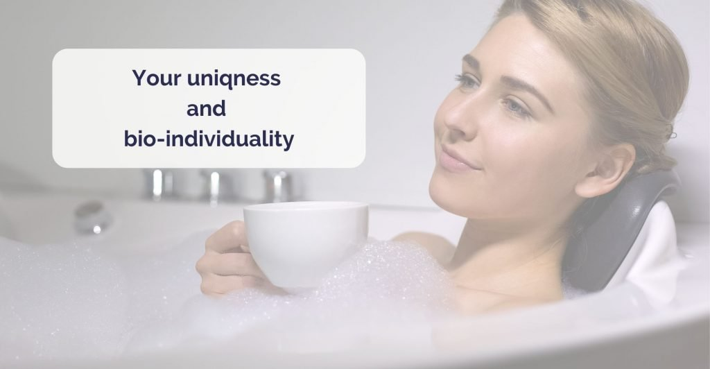 a woman with cup of tea relaxed in bath covered in foam. Caption 'your uniqness and bioindividuality'