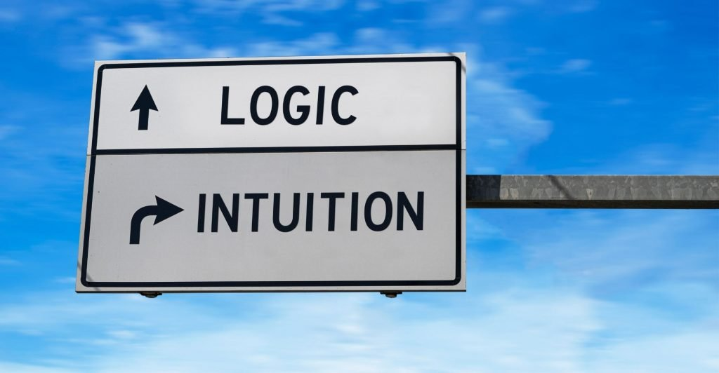 road sing straight on saying 'logic' and rigth saying 'intuition'